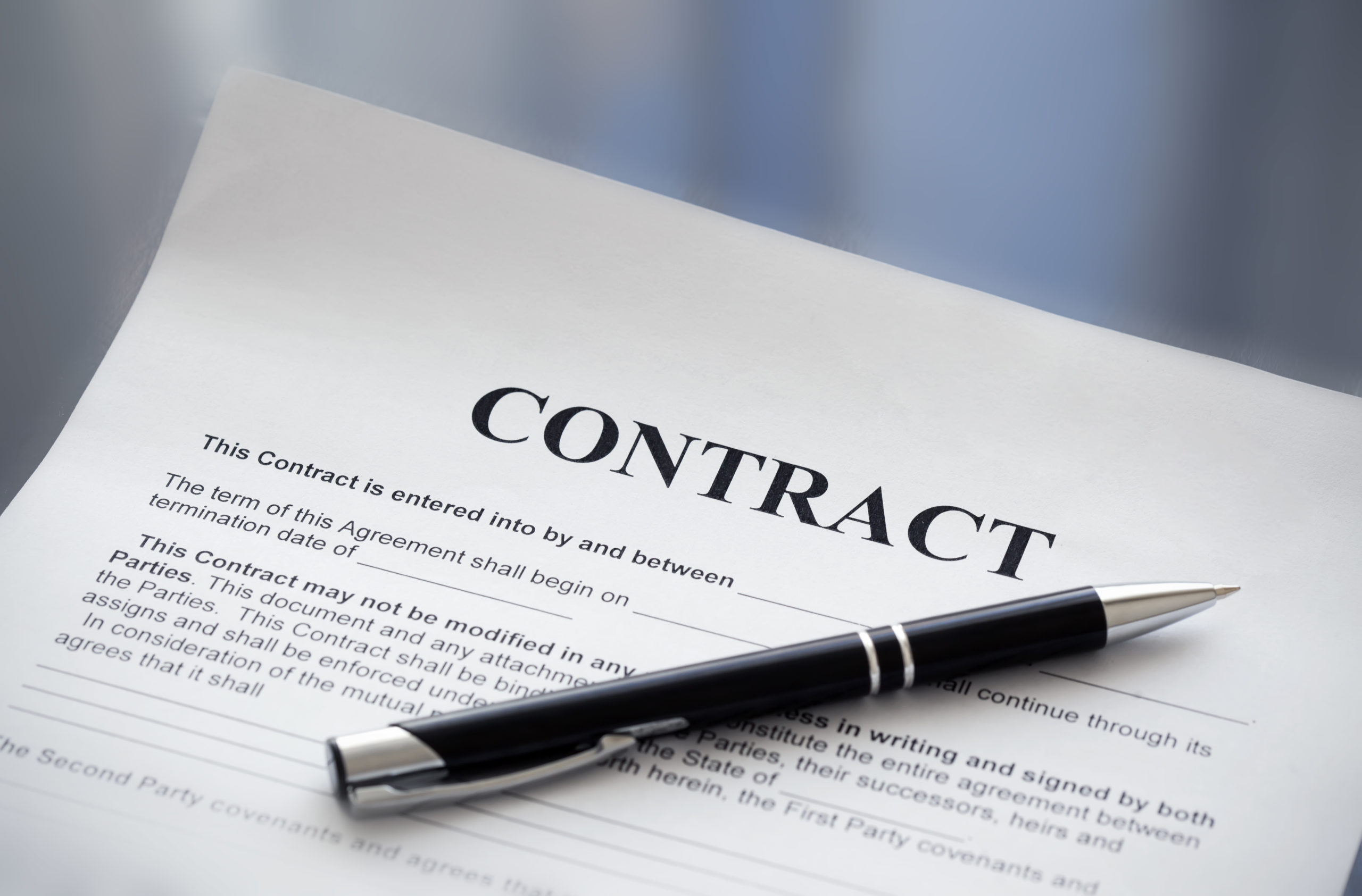 Picture of black pen on a paper with the word contract at the top.Basics of Surety Bonds